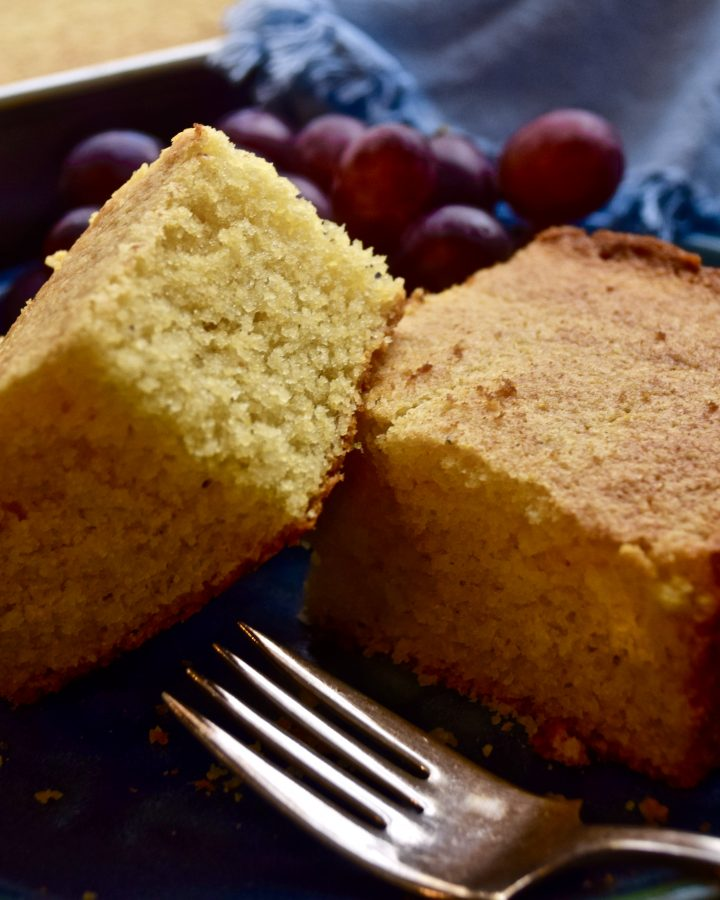 two pieces of cornbread on a plate