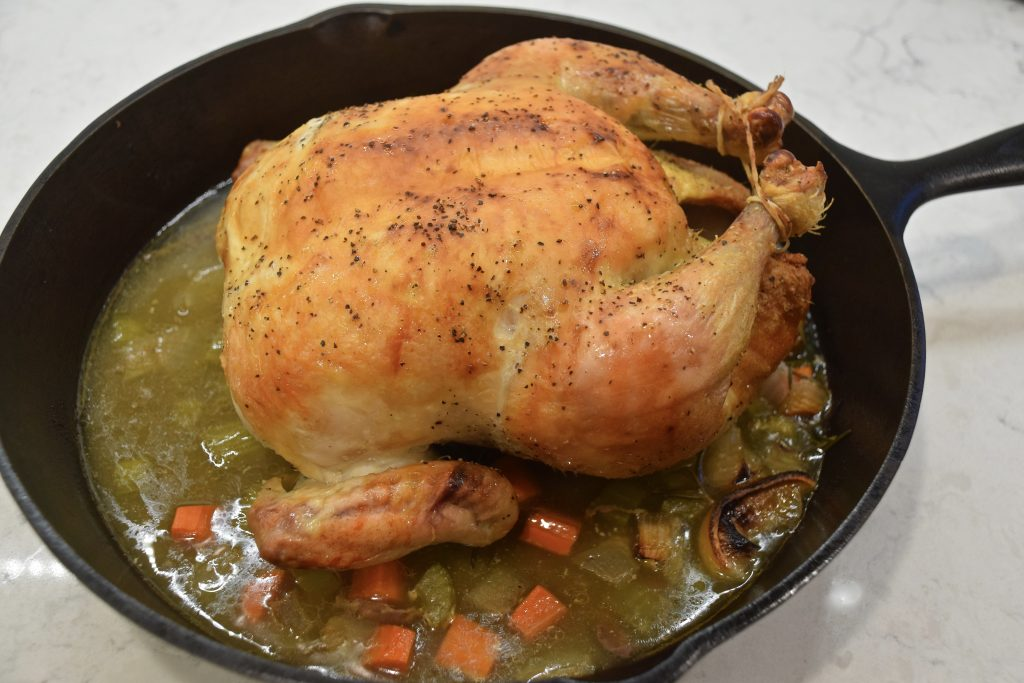 Roasted chicken in pan removed from oven