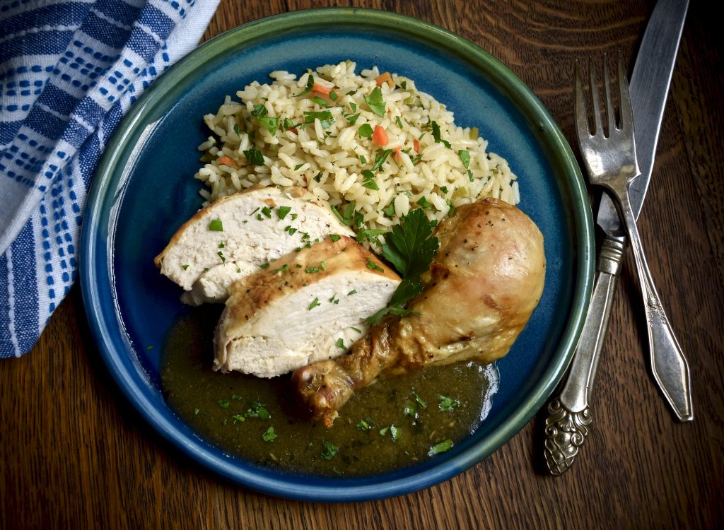 plated chicken with rice pilaf