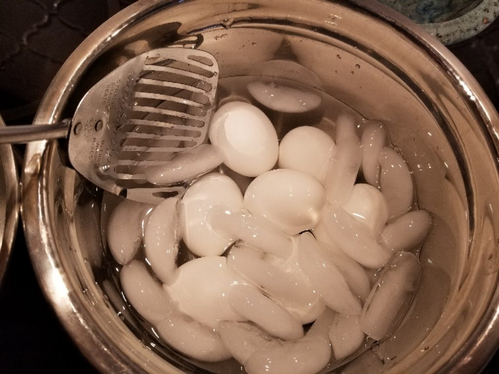 Cooked eggs in an ice bath
