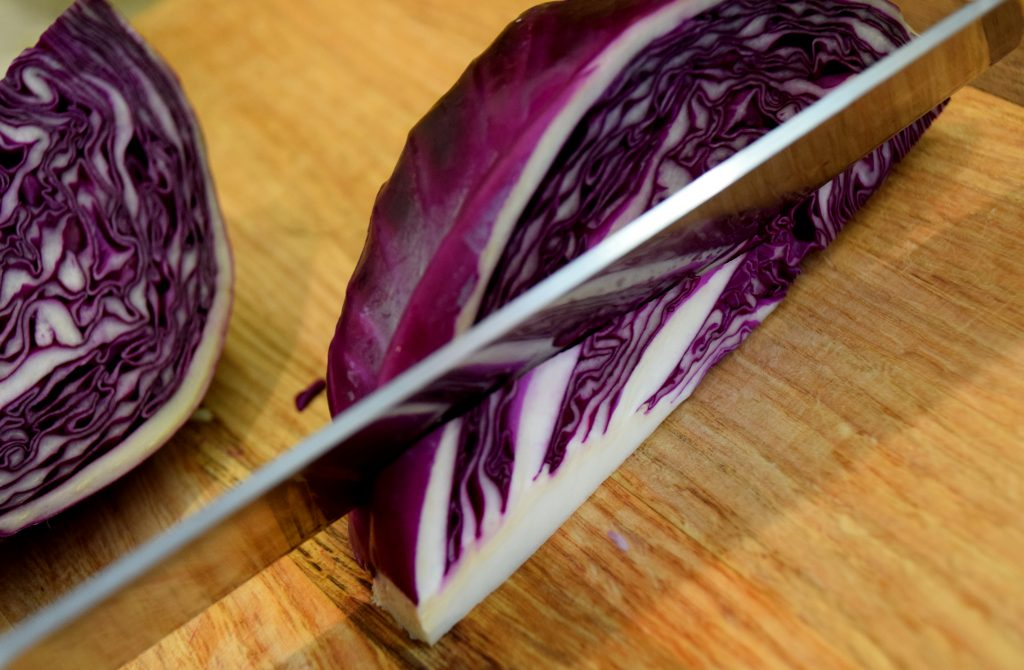 cutting core from red cabbage