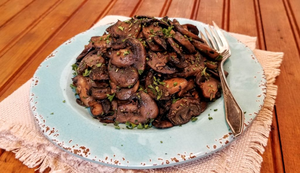 steamed and sautéed mushrooms with wine on plate