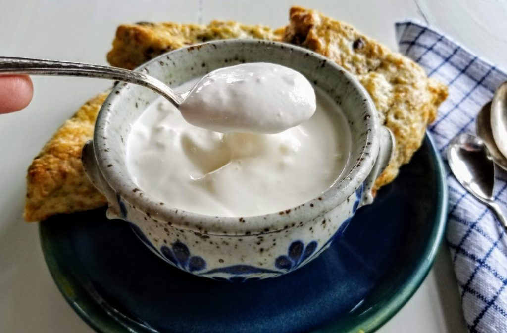 creme fraiche on spoon above bowl