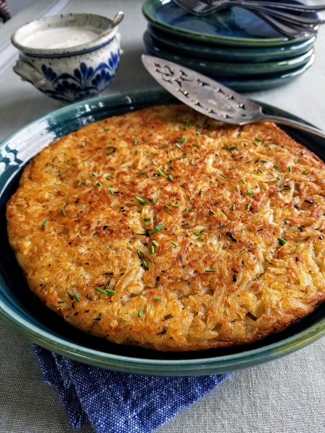 Crispy hash browns with serving spoon