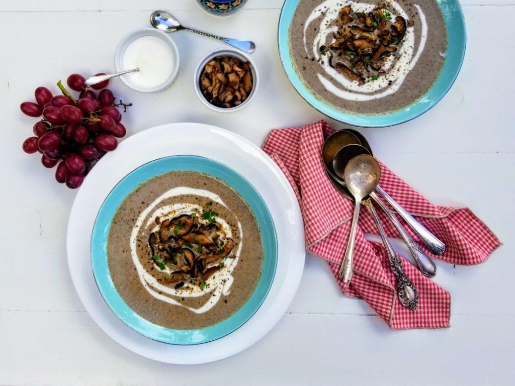 two bowls of homemade cream of mushroom soup