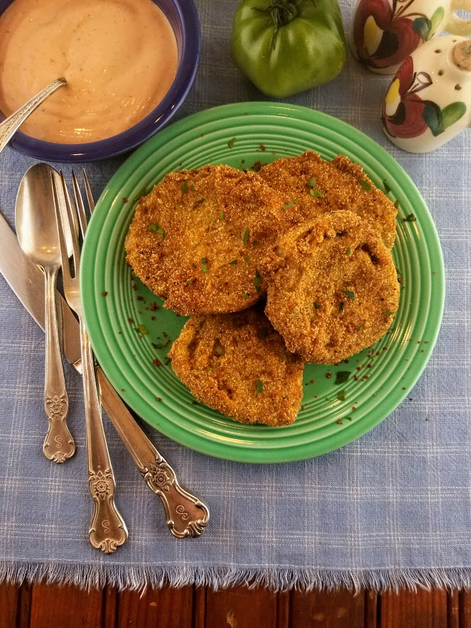 Fried green tomatoes on a green plate