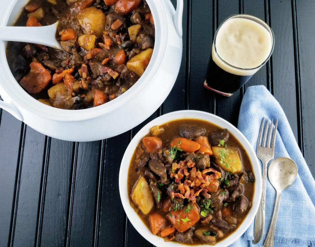 Venison and Stout Stew in a bowl and as well as in a tureen