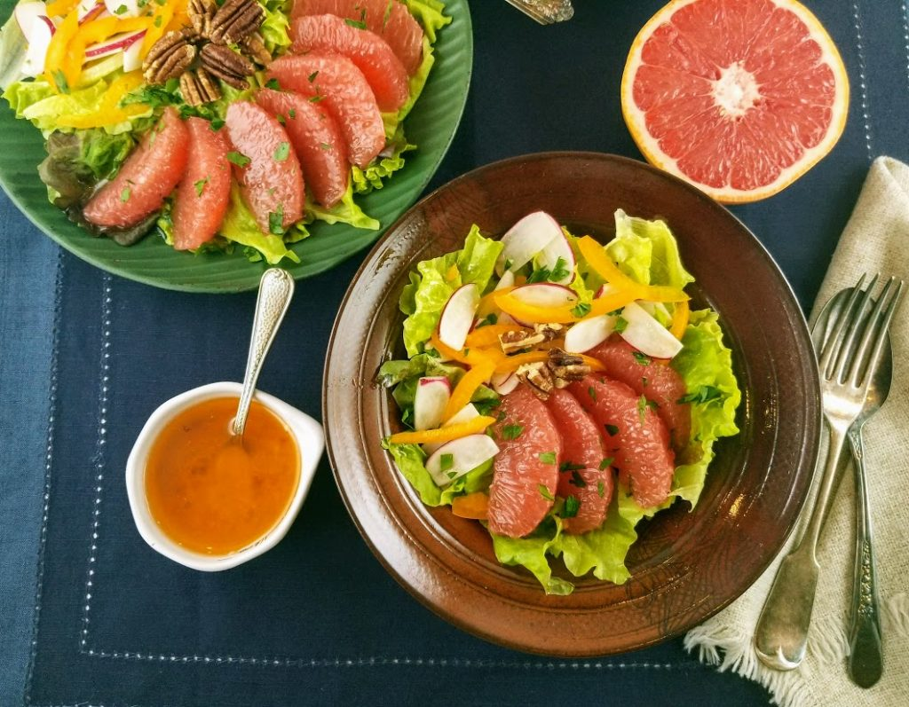 fresh grapefruit vinaigrette with green salad and cut grapefruit halves