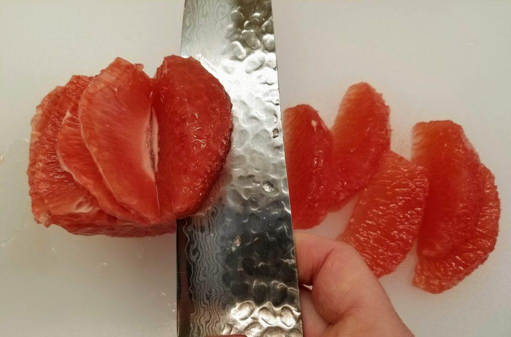 cutting away a grapefruit segment