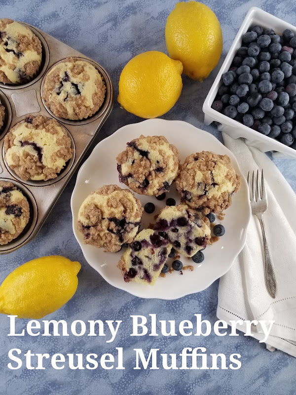 lemony blueberry streusel muffins with lemons and square basket of fresh blueberries