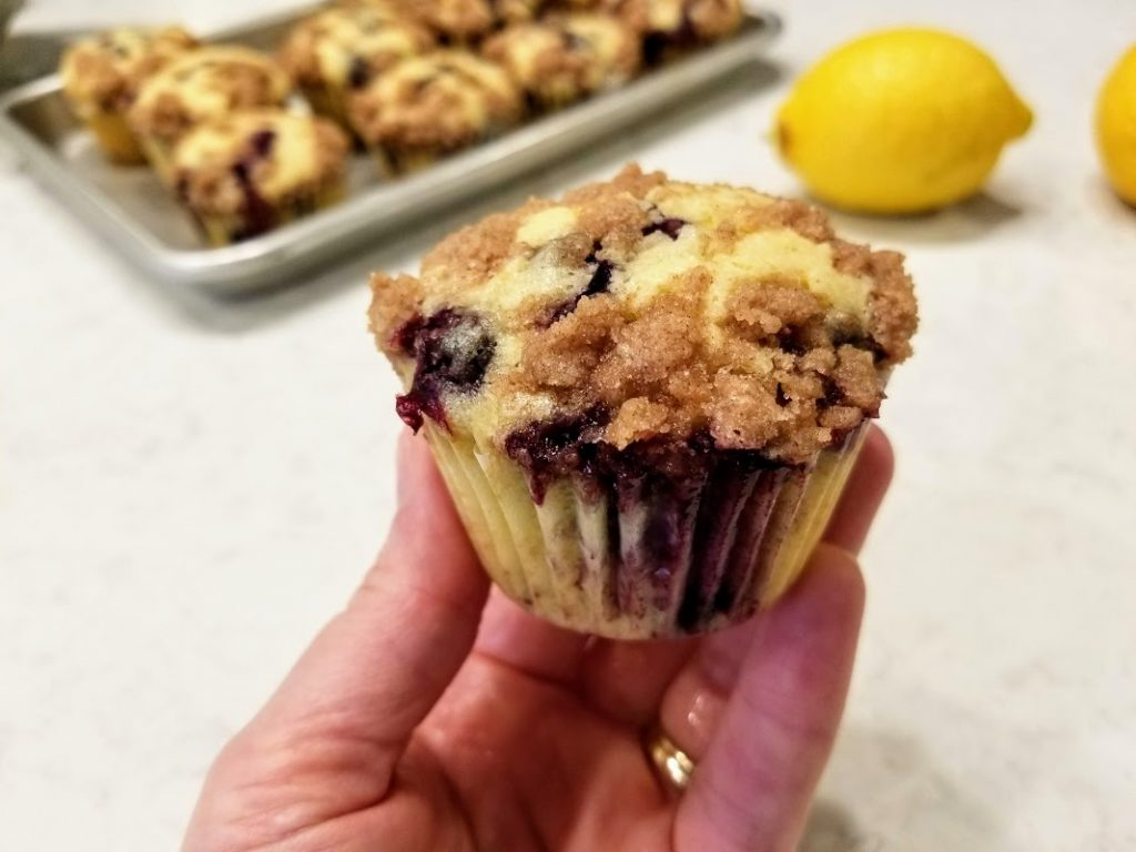 Lemon Blueberry Streusel Muffin being held in hand