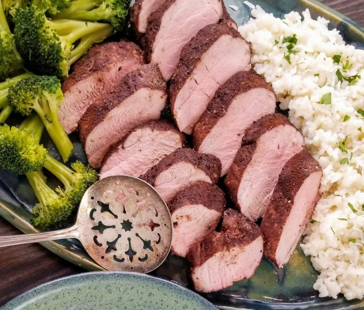 sliced pork tenderloin with cocoa spice rub on platter