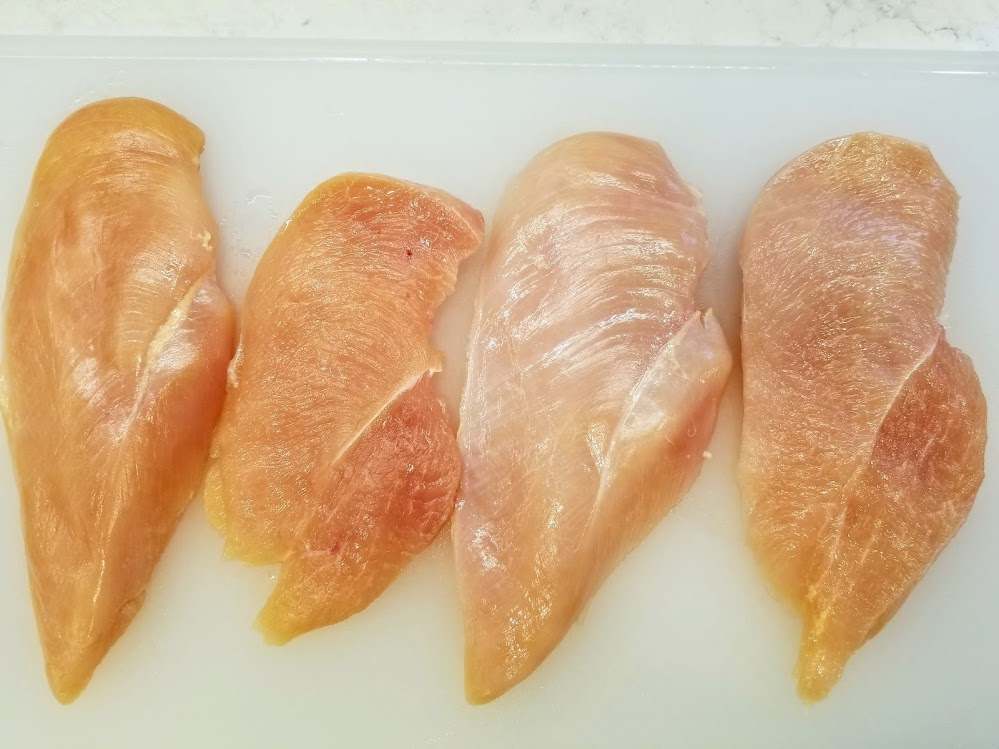 halved chicken breasts laid side by side