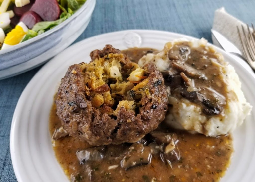 chestnut burr and mashed potatoes with gravy on a white plate