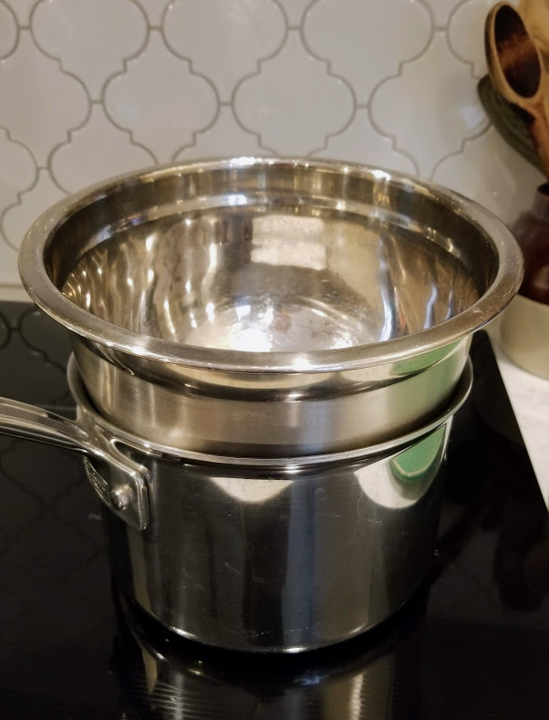 image of a stainless steel bowl in a pot to create a double boiler