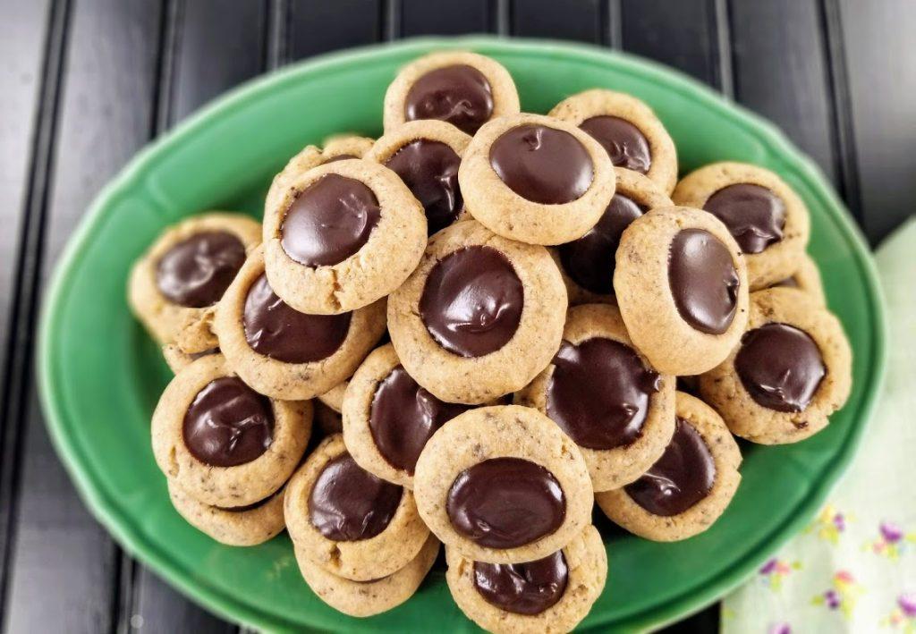 green platter of fudgy chocolate thumbprint cookies