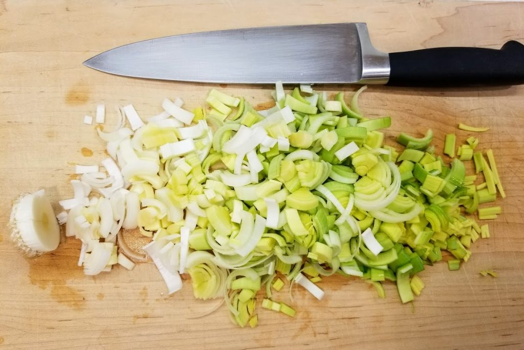 leek on board completely chopped, root end left